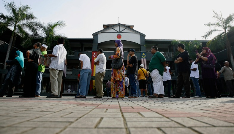 SHAH ALAM 5 May 2013. Malaysian population doing the poll at a polling centre during the 13th General Election (GE-13). GE-13 were held in Malaysia on 5 May 2013, following the dissolution of the Parliament announced by the Prime Minister on 3 April 2013 and elections in Malaysia follow the first-past-the-post system and are conducted by the Election Commission of Malaysia. Photo Adib Rawi Yahya