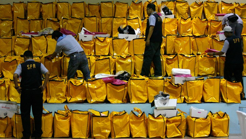SHAH ALAM 5 May 2013. Malaysia Election Commission officials inspect ballot boxes brought from polling stations and collected at the vote tally for the victory of a party who obtains the most votes during the 13th General Election (GE-13). Photo Adib Rawi Yahya