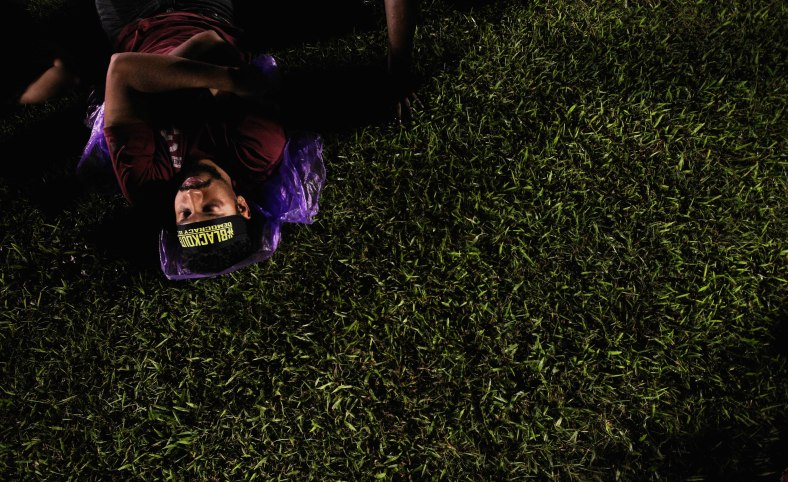 A demonstrator sleeping on the field during the 505 Assembly People's Voice at Padang timur, Amcorp Mall. Over ten thousand opposition supporters joined the rally in protest against the decision of the General Election 13th alleged vote fraud occurred. Photo Adib Rawi Yahya