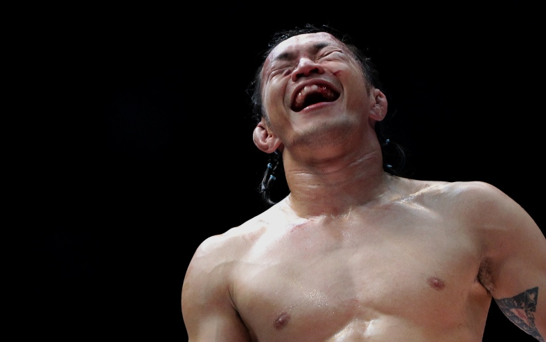 "KUALA LUMPUR 15 June 2013. Allen Solomon Chong aka ""Orang Hutan"" scream after defeating his opponent during Lightweight Championship Bout Malaysian Invasion Mixed Martial Arts Fighting (MIMMA) Championship Grand Finals at Stadium Merdeka. Photo Adib Rawi Yahya"