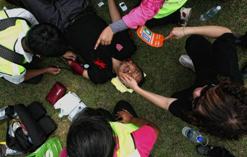KUALA LUMPUR 23 June 2013. A demonstrators treated after sudden fainting during the Black 505 rally to protest against the decision of the General Election 13th alleged vote fraud occurred at Padang Merbok. Photo Adib Rawi Yahya