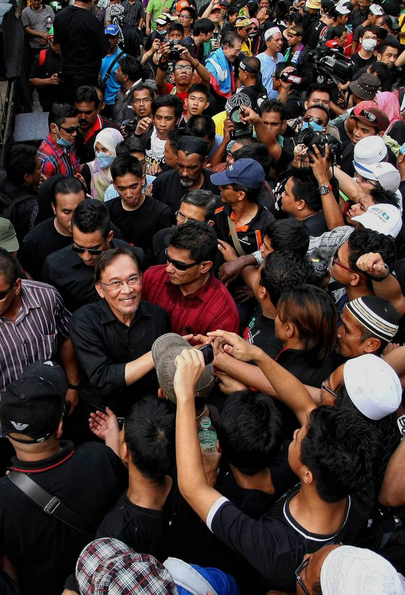 KUALA LUMPUR 23 June 2013. Malaysian Opposition Leader, Anwar Ibrahim shake hands with his supporters as he leaves the Black 505 rally to protest against the decision of the General Election 13th alleged vote fraud occurred at Padang Merbok. Photo Adib Rawi Yahya