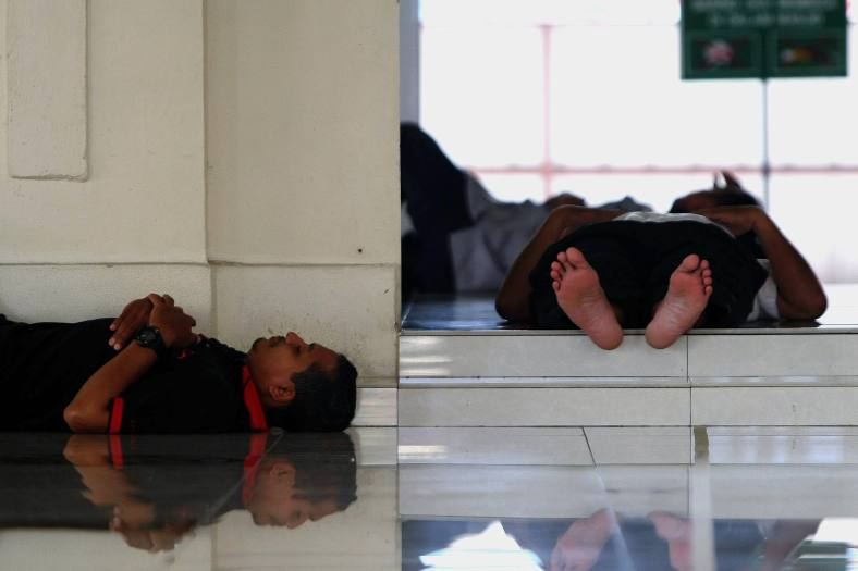 KUALA LUMPUR 10 July 2013. A Muslim men take a rest while waiting for breaking fast on the first day of holy month of Ramadan at Jamek mosque, Kampung Baru. Ramadan is the ninth month of the Islamic calendar, Islam's holy month of Ramadan is celebrated by Muslims worldwide marked by fasting, abstaining from foods, sex and smoking from dawn to dusk for soul cleansing and strengthening the spiritual bond between them and the Almighty. Photo Adib Rawi Yahya