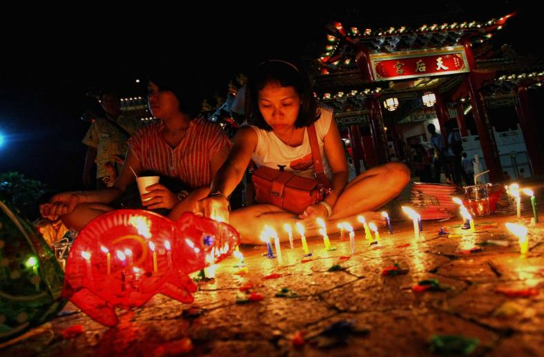 A Chinese woman celebrates the lantern festival during the Lantern Festival at Thean Hou Temple in Kuala Lumpur on September 19, 2013. Lantern Festival or better known as Mid-Autumn festival is celebrated on the 15th day of the eight month in the Chinese calender during a full moon which is in late September or early October in the Gregorian calendar. Photo Adib Rawi Yahya