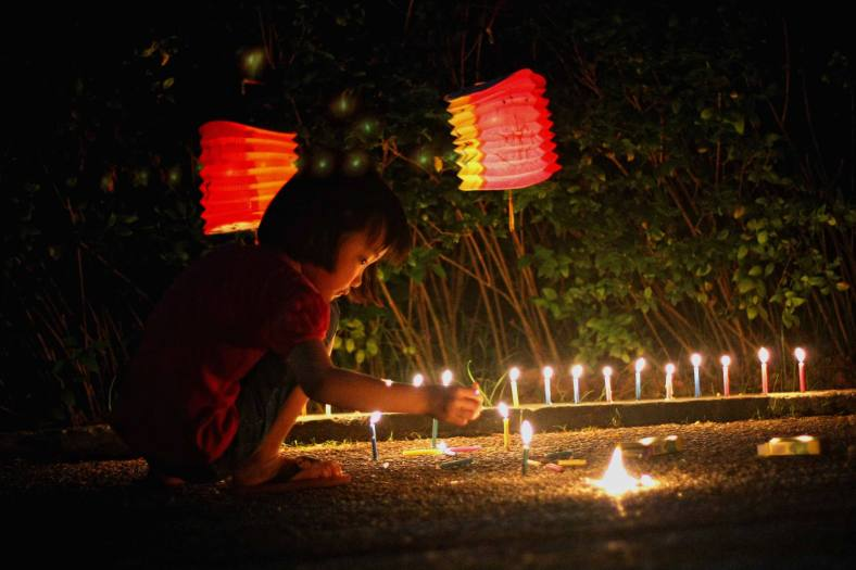 A Chinese kids celebrates the lantern festival during the Lantern Festival at Thean Hou Temple in Kuala Lumpur on September 19, 2013. Lantern Festival or better known as Mid-Autumn festival is celebrated on the 15th day of the eight month in the Chinese calender during a full moon which is in late September or early October in the Gregorian calendar. Photo Adib Rawi Yahya