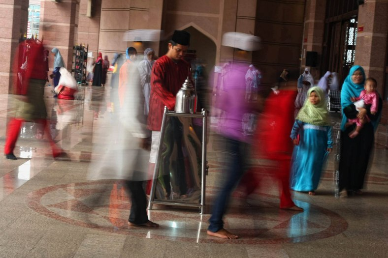 Muslims seem present to the mosque for prayers during the Eid al-Adha festival at Putrajaya outside Kuala Lumpur on October 15, 2013. Eid al-Adha is an important religious holiday celebrated by Muslims worldwide to honour the willingness of the prophet Abraham to sacrifice his young first-born son Ismail a as an act of submission to Allah's command and his son's acceptance to being sacrificed, before Allah intervened to provide Abraham with a lamb to sacrifice instead. Photo Adib Rawi Yahya