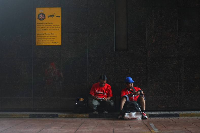 Behavior of some participants take photos according to theme given during the Canon PhotoMarathon 2013 around the city Kuala Lumpur on November 16, 2013. Canon PhotoMarathon Asia 2013 hold a seventh edition of the region's largest photo competition and will have a junior category, enabling young enthusiasts under 18 years to compete. Also, the competition will be run in a different format and participants stand a chance to win attractive prizes amounting up to RM30,000 and the grand and first-prize winners of the open category will walk away with a trip to Kansai, Japan, to attend a photo clinic conducted by the award-winning photographer, Triston Yeo. photo Adib Rawi Yahya