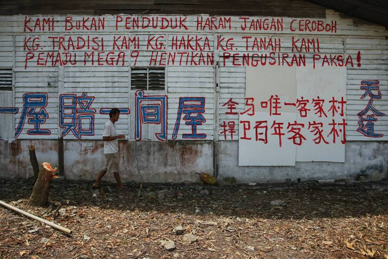 Hakka villagers warn the developer of Mega 9 by writing on wooden boards to not remove them from the Hakka village following the issue of demolition kampung Hakka had occur on last September 30, a total of more than 80 families in the village were ordered out by the Seremban High Court after the land has been purchased by a developer. The dispute between the villagers and the developer began in 2011 after they were ordered vacate an area of about 15 acres to make way for the Mega 9 developers for commercial development. Photo Adib Rawi Yahya