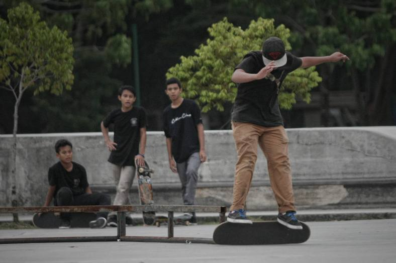 A boy doing stunt jumps with a skateboard during school holiday outside Kuala Lumpur on November 25, 2013. Malaysian public schools are closed for the year-end holidays. photo Adib Rawi Yahya