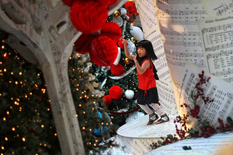 A kid playing near the Christmas decorations at a shopping mall inside Kuala Lumpur on 18 December, 2013. Christmas is the biggest festival of Christians, is celebrated every year on December 25 to commemorate the birth (in which the facts, the date is not the date of his birth) Jesus Christ, also known as Jesus of Nazareth, the founder of the Christian message. According to the Bible, New Testament, Jesus was born to Mary (Virgin Mary) in Jerusalem. Christians believe that Jesus' birth was within Judaism predictions about the coming of a savior (Messiah) from a chronology of King David, whose coming was to redeem mankind from Adam's sin (original sin). Photo Adib Rawi Yahya
