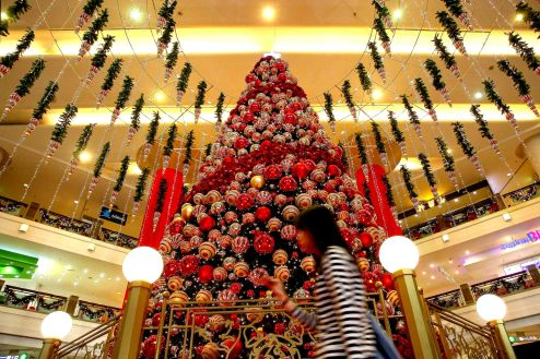 A girl crossing the Christmas tree decorations at a shopping mall inside Kuala Lumpur on 18 December, 2013. Christmas is the biggest festival of Christians, is celebrated every year on December 25 to commemorate the birth (in which the facts, the date is not the date of his birth) Jesus Christ, also known as Jesus of Nazareth, the founder of the Christian message. According to the Bible, New Testament, Jesus was born to Mary (Virgin Mary) in Jerusalem. Christians believe that Jesus' birth was within Judaism predictions about the coming of a savior (Messiah) from a chronology of King David, whose coming was to redeem mankind from Adam's sin (original sin). Photo Adib Rawi Yahya