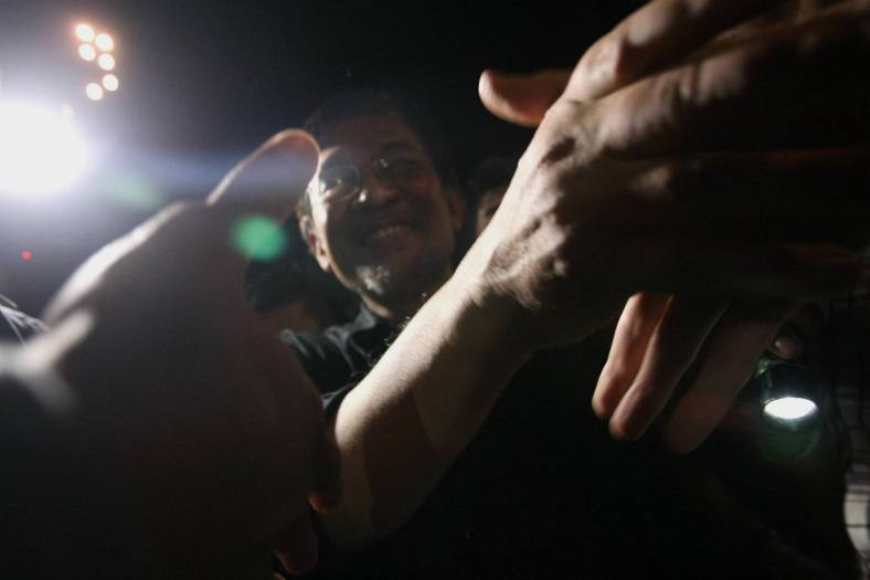 Malaysian Opposition Leader Anwar Ibrahim shake hands with his supporters as he leaves the Reformasi 2.0 rally at Kajang Stadium on March 21, 2014. Over six thousand opposition supporters joined the rally and the opposition leader says he still defends the 'Kajang Move' as it will pave the way for Pakatan to take over Putrajaya no matter what happens to him. photo Adib Rawi Yahya