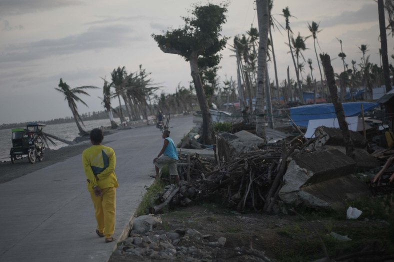 A resident-survivor of super Typhoon Haiyan walk near their shelter, along the coastal area of Tacloban City at Tacloban city on March 7, 2014. Typhoon Haiyan, one of the most powerful typhoons ever recorded, hit into central Philippine provinces, and left a wide destruction. The United Nations warned on February 15 2014 that millions of survivors of the Philippines deadliest typhoon were still without adequate shelter 100 days after the disaster. Photo Adib Rawi Yahya