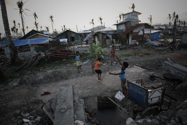 A young-survivor of super Typhoon Haiyan play near their shelter, along the coastal area of Tacloban City at Tacloban city on March 7, 2014. Typhoon Haiyan, one of the most powerful typhoons ever recorded, hit into central Philippine provinces, and left a wide destruction. The United Nations warned on February 15 2014 that millions of survivors of the Philippines deadliest typhoon were still without adequate shelter 100 days after the disaster. Photo Adib Rawi Yahya