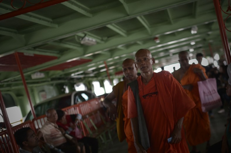 "Monks looks on a ferry on May 16, 2014. The name ""Penang"" comes from the modern Malay name Pulau Pinang, which means ""island of the areca nut palm"". Penang is a smallest Malaysian state in area after Perlis and ranked the eighth most populous. This state has third-highest Human Development Index in Malaysia, after the state of Selangor and the federal territory of Kuala Lumpur. Its heterogeneous population is highly diverse in ethnicity, culture, language, and religion. Photo Adib Rawi Yahya"