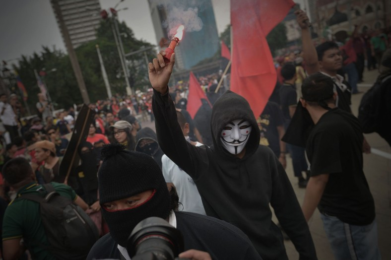 during a May Day protest anti-GST in Kuala Lumpur on May 1, 2014. Malaysia's opposition and activists demonstrate on May Day also known as Labour Day, which drew more than 20,000 people gathered due to dissatisfaction against the rising cost of living due to reduced subsidies and increased taxes. Photo Adib Rawi Yahya