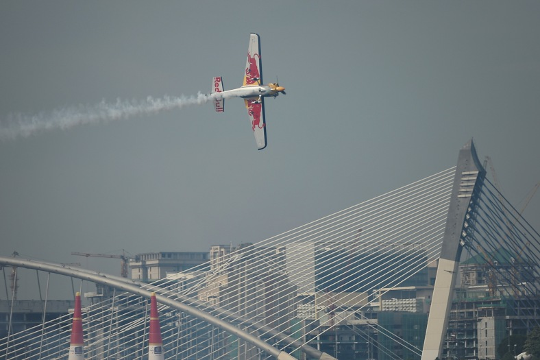 Kirby Chambliss from USA using aircraft type Zivko Edge 540 V3 action during the Red Bull Air Race World Championship 2014 in Putrajaya on May 17, 2014. The tournament was held over two days from May 17 to May 18, 2014. Photo Adib Rawi Yahya