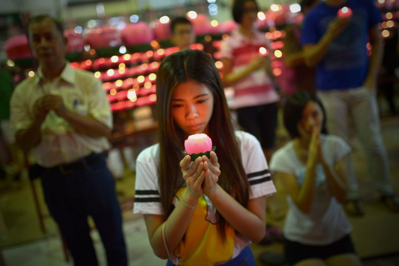 A woman offers prays ahead of Wesak Day celebration at Penang on May 13, 2014. Wesak Day which is the most important of the Buddhist festivals and it is a day to pay homage to Lord Buddha on his birthday and to celebrate his attainment of enlightment as well as to commemorate his death. Photo Adib Rawi Yahya