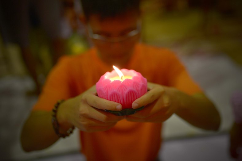 A man offers prays ahead of Wesak Day celebration at Penang on May 13, 2014. Wesak Day which is the most important of the Buddhist festivals and it is a day to pay homage to Lord Buddha on his birthday and to celebrate his attainment of enlightment as well as to commemorate his death. Photo Adib Rawi Yahya