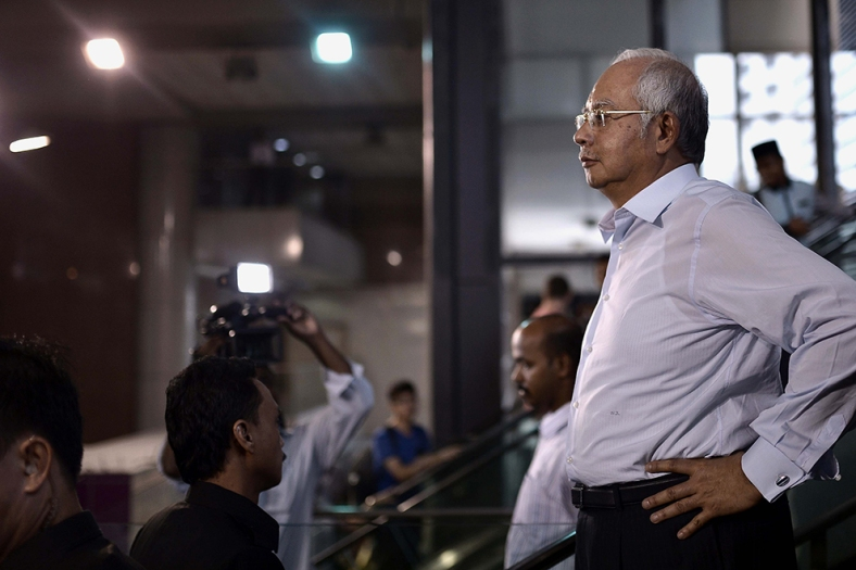 Malaysia Prime Minister Najib Razak attend during a visit at one of the new shopping center inside Kuala Lumpur on June 05, 2014. Photo Adib Rawi Yahya