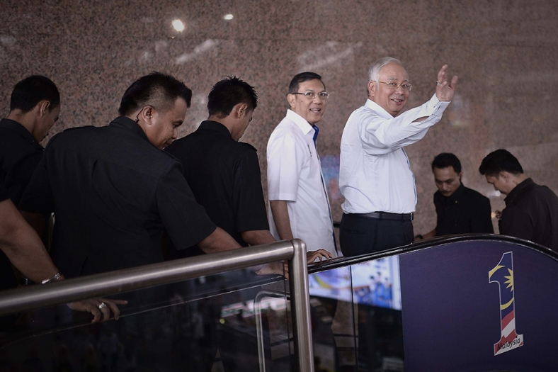 Malaysia Prime Minister Najib Razak wave hands to the media during a visit at one of the new shopping center inside Kuala Lumpur on June 05, 2014. Photo Adib Rawi Yahya