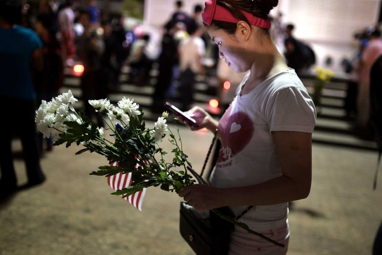 An unidentified woman holds flower during a special prayer vigil for the ill fated Malaysia Airlines, MH17 in Kuala Lumpur on July 22, 2014. Malaysia Airlines Flight 17 was a scheduled international passenger flight from Amsterdam to Kuala Lumpur that crashed on 17 July 2014. The plane is believed to have been shot down with a Buk surface-to-air missile and killing all 283 passengers and 15 crew on board. The crash occurred in the conflict zone of the ongoing Donbass insurgency, in an area controlled by the Donbass People's Militia. Photo Adib Rawi Yahya