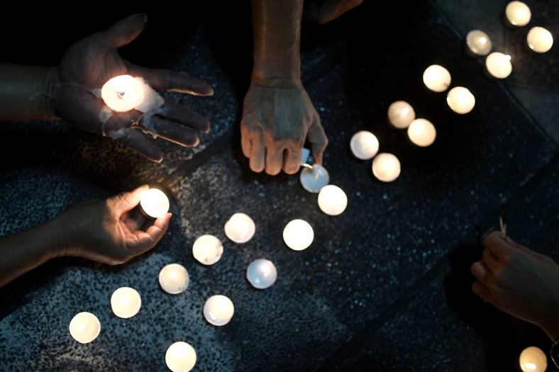 People lights candle during a special prayer vigil for the ill fated Malaysia Airlines, MH17 in Kuala Lumpur on July 22, 2014. Malaysia Airlines Flight 17 was a scheduled international passenger flight from Amsterdam to Kuala Lumpur that crashed on 17 July 2014. The plane is believed to have been shot down with a Buk surface-to-air missile and killing all 283 passengers and 15 crew on board. The crash occurred in the conflict zone of the ongoing Donbass insurgency, in an area controlled by the Donbass People's Militia. Photo Adib Rawi Yahya