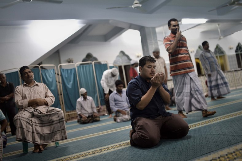 Malaysian Muslims men prays after perform prayers known as Tarawih on the holy Islamic month of Ramadan in Kuala Lumpur on July 02, 2014. Ramadan is the ninth month of the Islamic calendar, Islam's holy month of Ramadan is celebrate by Muslims worldwide mark by fasting, abstain from eating, drinking, having sex and smoking from dawn to dusk to cleanse the soul and strengthen the spiritual bond between them and the almighty. Photo Adib Rawi Yahya