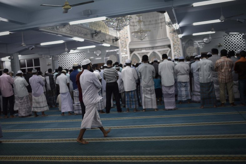 Malaysian Muslims men perform prayers known as Tarawih on the holy Islamic month of Ramadan in Kuala Lumpur on July 02, 2014. Ramadan is the ninth month of the Islamic calendar, Islam's holy month of Ramadan is celebrate by Muslims worldwide mark by fasting, abstain from eating, drinking, having sex and smoking from dawn to dusk to cleanse the soul and strengthen the spiritual bond between them and the almighty. Photo Adib Rawi Yahya