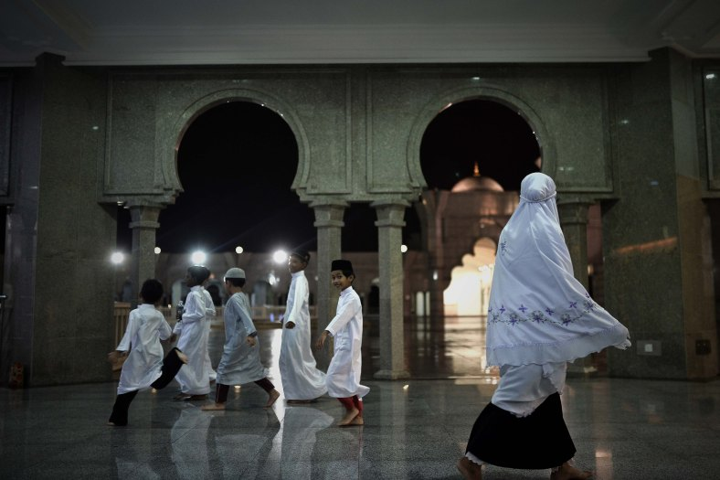 Young Malaysian Muslims children run to perform prayers known as Tarawih on the holy Islamic month of Ramadan in Kuala Lumpur on July 02, 2014. Ramadan is the ninth month of the Islamic calendar, Islam's holy month of Ramadan is celebrate by Muslims worldwide mark by fasting, abstain from eating, drinking, having sex and smoking from dawn to dusk to cleanse the soul and strengthen the spiritual bond between them and the almighty. Photo Adib Rawi Yahya