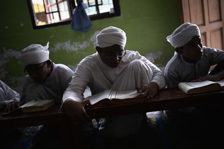 Malaysian religious student reads the Koran at school during the Muslim holy fasting month of Ramadan in Sungai Buloh, suburb of Kuala Lumpur on July 08, 2014. Ramadan is the ninth month of the Islamic calendar, Islam's holy month of Ramadan is celebrate by Muslims worldwide mark by fasting, abstain from eating, drinking, having sex and smoking from dawn to dusk to cleanse the soul and strengthen the spiritual bond between them and the almighty. Photo Adib Rawi Yahya