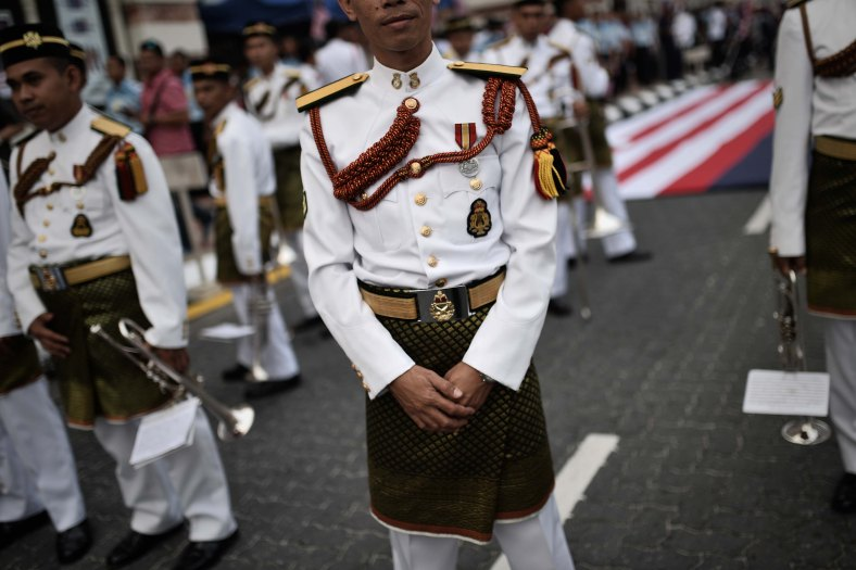 The Royal Malay Regiment Band wait to perform during the 57th Merdeka celebrations at Dataran Merdeka in Kuala Lumpur on August 31, 2014. 'Malaysia...Di Sini Lahirnya Sebuah Cinta' is the official theme of this year's Merdeka. The theme is taken from the lyrics of the song 'Warisan' popularised by the late Sudirman Haji Arshad. Photo Adib Rawi Yahya