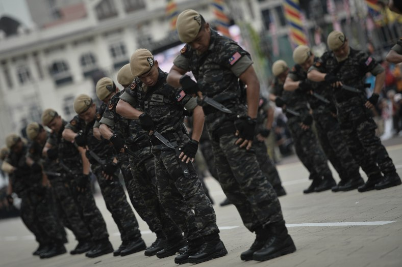 Members of Malaysian Special Operations Force march during a rehearsal for the 57th Merdeka celebrations at Dataran Merdeka in Kuala Lumpur on August 29, 2014. 'Malaysia...Di Sini Lahirnya Sebuah Cinta' is the official theme of this year's Merdeka. The theme is taken from the lyrics of the song 'Warisan' popularised by the late Sudirman Haji Arshad. Photo Adib Rawi Yahya