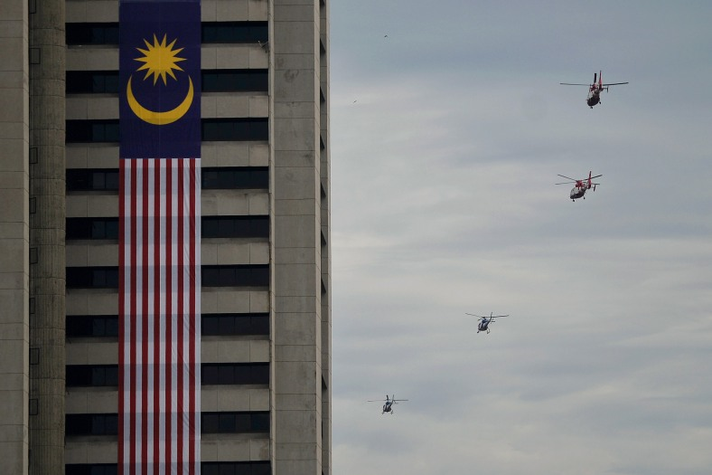 Fire and Rescue Department helicopter past the giant National flags during a rehearsal for the 57th Merdeka celebrations at Dataran Merdeka in Kuala Lumpur on August 29, 2014. 'Malaysia...Di Sini Lahirnya Sebuah Cinta' is the official theme of this year's Merdeka. The theme is taken from the lyrics of the song 'Warisan' popularised by the late Sudirman Haji Arshad. Photo Adib Rawi Yahya