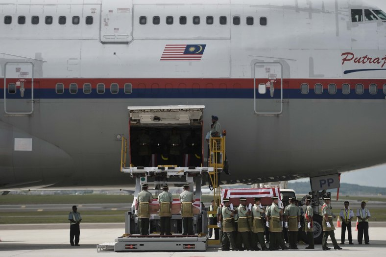 Soldiers carry a coffin with the remains of a Malaysian victim from the Malaysia Airlines flight MH17 that crashed in Ukraine during rehearsal of the ceremony honouring at KL International Airport (KLIA) on August 21, 2014. A plane bring back home the first remains of the 43 Malaysians on the ill-fated Malaysia Airlines plane that was shot down in east of Ukraine on July 17 during a flight from Amsterdam to Kuala Lumpur. In total 298 people lost their lives in the tragedy. Photo Adib Rawi Yahya