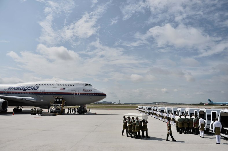 The aircraft carrying the remains of victims of the MH17 disaster at the tarmac of the KL International Airport (KLIA) during rehearsal of the ceremony honouring on August 21, 2014. A plane bring back home the first remains of the 43 Malaysians on the ill-fated Malaysia Airlines plane that was shot down in east of Ukraine on July 17 during a flight from Amsterdam to Kuala Lumpur. In total 298 people lost their lives in the tragedy. Photo Adib Rawi Yahya