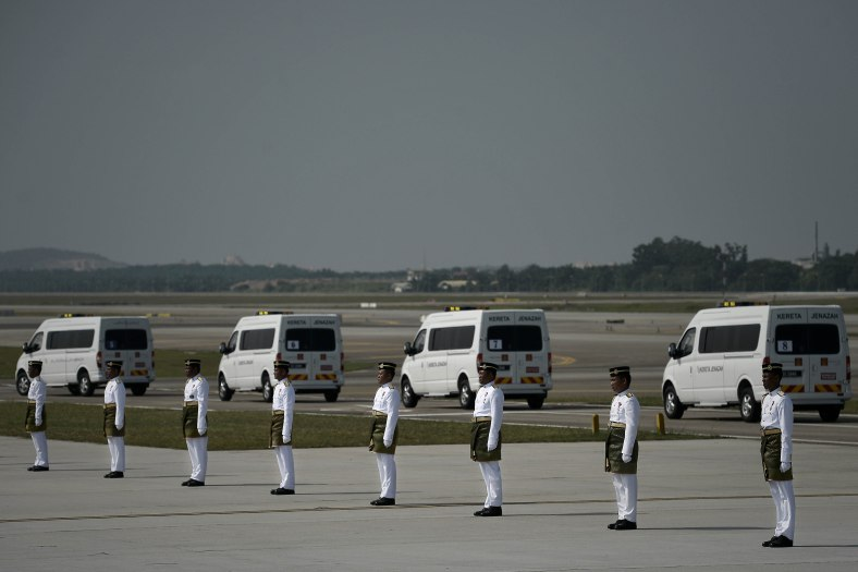 Hearses carrying the remains of the victims of Malaysia Airlines (MAS) flight MH17 plane crash during of the ceremony honouring on August 22, 2014. A plane bring back home the first remains of the 43 Malaysians on the ill-fated Malaysia Airlines plane that was shot down in east of Ukraine on July 17 during a flight from Amsterdam to Kuala Lumpur. In total 298 people lost their lives in the tragedy. Photo Adib Rawi Yahya
