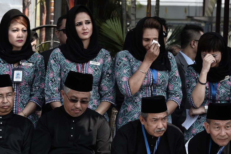 Malaysia Airlines (MAS) flight attendants tears during of the ceremony honouring at KL International Airport (KLIA) on August 22, 2014. A plane bring back home the first remains of the 43 Malaysians on the ill-fated Malaysia Airlines plane that was shot down in east of Ukraine on July 17 during a flight from Amsterdam to Kuala Lumpur. In total 298 people lost their lives in the tragedy. Photo Adib Rawi Yahya