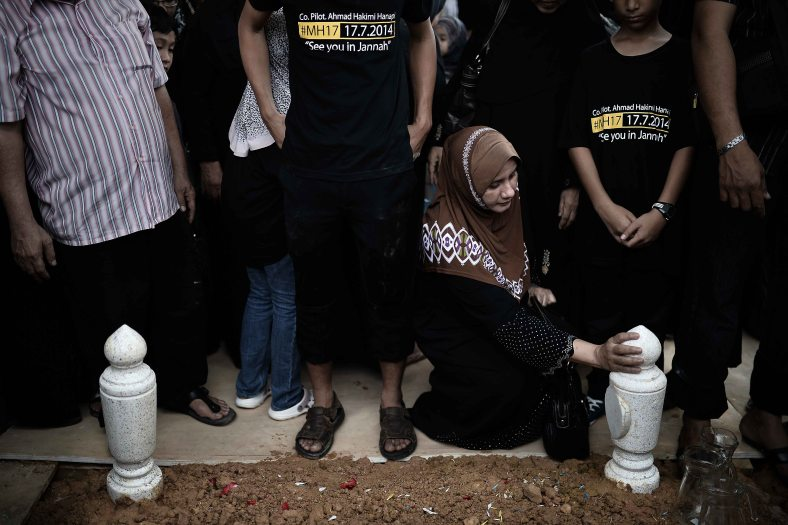 Relatives of late co-pilot Ahmad Hakimi Hanapi, who perished aboard flight MH17 downed in eastern Ukraine, attends a burial ceremony in Putrajaya, outside Kuala Lumpur on August 22, 2014. A plane bring back home the first remains of the 43 Malaysians on the ill-fated Malaysia Airlines plane that was shot down in east of Ukraine on July 17 during a flight from Amsterdam to Kuala Lumpur. In total 298 people lost their lives in the tragedy. Photo Adib Rawi Yahya