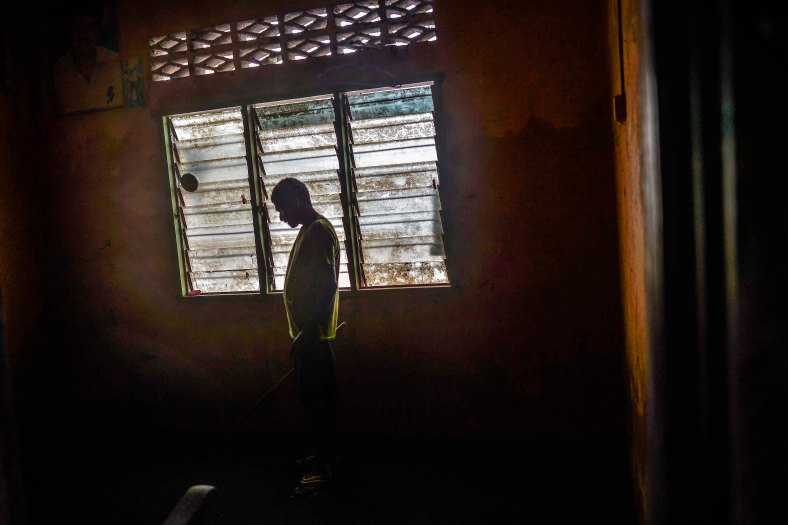A resident stands inside his bedroom that was flooded in heavy rains at Temerloh, Pahang on January 04, 2015. In Pahang, 29,547 evacuees were recorded in 126 centres in seven affected areas. Temerloh has the 2nd largest number of victims with 10,576 people after Pekan. photo Adib Rawi Yahya