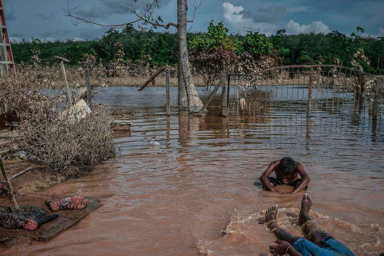 A boy sits in floodwaters at Temerloh, Pahang on January 03, 2015. In Pahang, 29,547 evacuees were recorded in 126 centres in seven affected areas. Temerloh has the 2nd largest number of victims with 10,576 people after Pekan. photo Adib Rawi Yahya