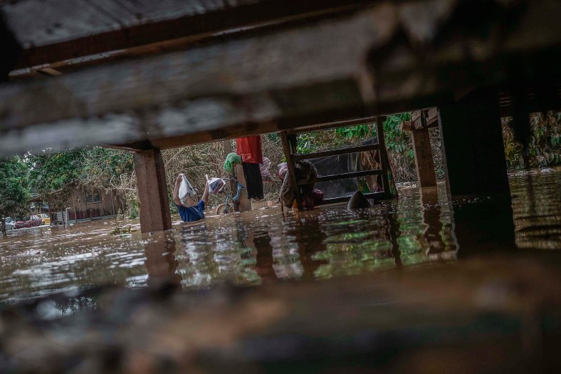 A resident through the flood while carrying relief goods at Temerloh, Pahang on January 04, 2015. In Pahang, 29,547 evacuees were recorded in 126 centres in seven affected areas. Temerloh has the 2nd largest number of victims with 10,576 people after Pekan. photo Adib Rawi Yahya