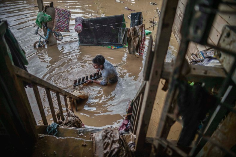 A resident cleans out his house belongings that was flooded in heavy rains at Temerloh, Pahang on January 04, 2015. In Pahang, 29,547 evacuees were recorded in 126 centres in seven affected areas. Temerloh has the 2nd largest number of victims with 10,576 people after Pekan. photo Adib Rawi Yahya