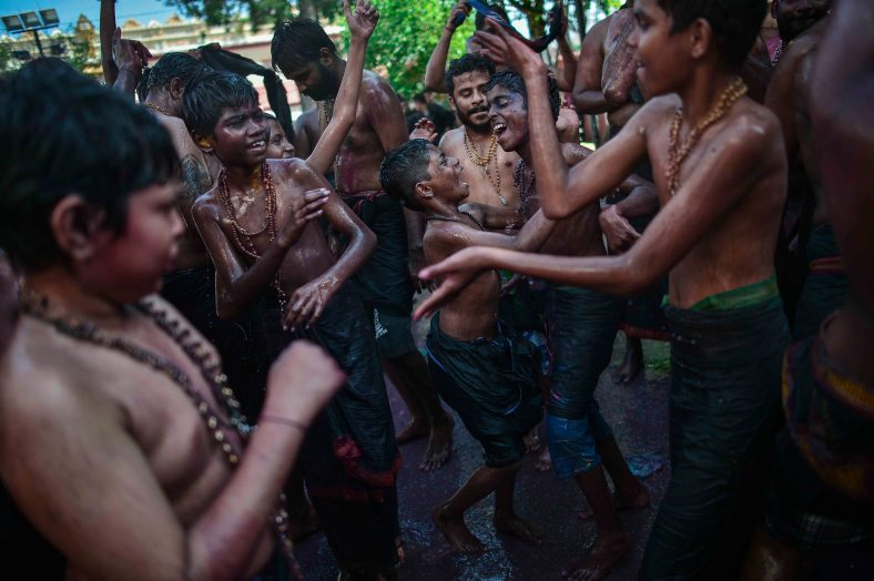 Malaysian ethnic Hindu take shower as a symbol for offering before heading towards Ayyappa Makara temple during Makara Jyothi festival in Penang on January 14, 2015. Makara Jyothi is a star which is worshiped by pilgrims in huge numbers on 14 January every year. However many devout Hindus claim that Makara Jyothi is the celestial lighting which takes place on Makara Sankranthi day and they believe that Lord Ayyappa asserts himself as Makara Jyothi to bless his devotees. photo Adib Rawi Yahya