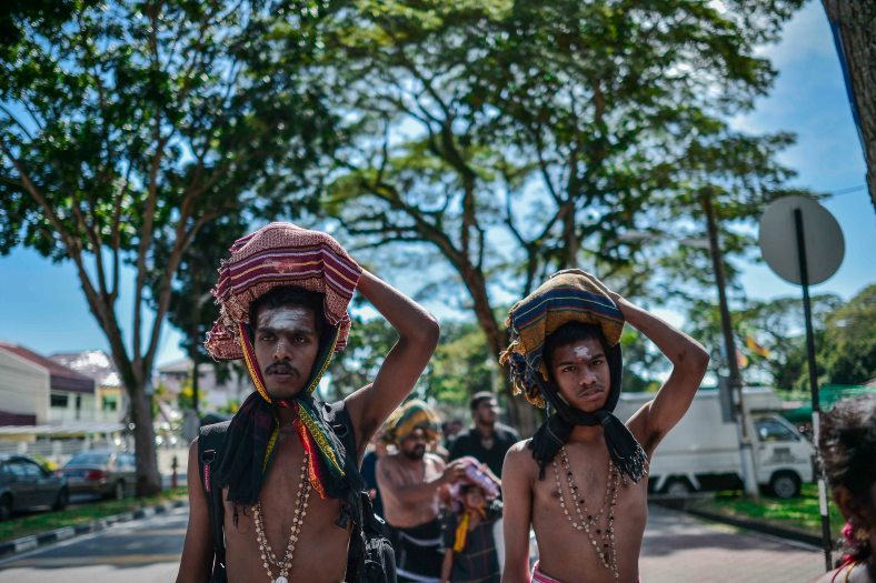 Malaysian ethnic Hindu carry fabric as a symbol for offering as they climb 265 stairs toward Ayyappa Makara temple during Makara Jyothi festival in Penang on January 14, 2015. Makara Jyothi is a star which is worshiped by pilgrims in huge numbers on 14 January every year. However many devout Hindus claim that Makara Jyothi is the celestial lighting which takes place on Makara Sankranthi day and they believe that Lord Ayyappa asserts himself as Makara Jyothi to bless his devotees. photo Adib Rawi Yahya
