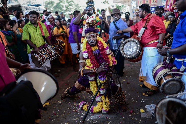 Malaysian Hindu devotees perform their religious rites before they walk toward the Batu Caves temple during the Thaipusam festival at Batu Caves outskirts of Kuala Lumpur on February 02, 2015. The Hindu festival of Thaipusam, which commemorates the day when Goddess Pavarthi gave her son Lord Muruga an invincible lance with which he destroyed evil demons, is celebrated by some two million ethnic Indians in Malaysia and Singapore. photo Adib Rawi Yahya