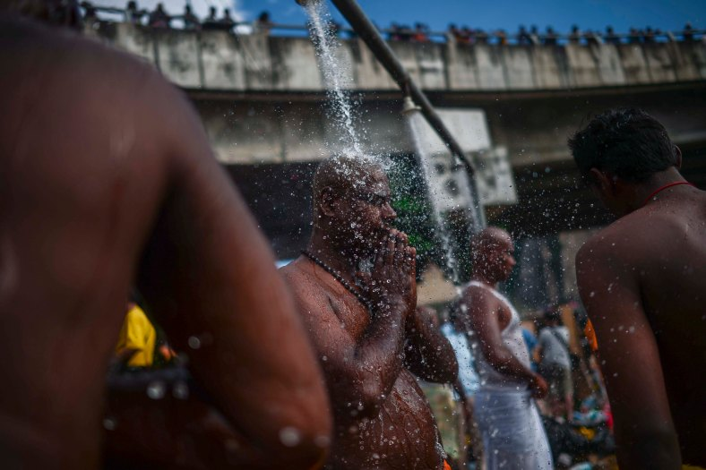 Malaysian Hindu devotees performs a ritual bath during the Thaipusam festival at Batu Caves outskirts of Kuala Lumpur on February 03, 2015. The Hindu festival of Thaipusam, which commemorates the day when Goddess Pavarthi gave her son Lord Muruga an invincible lance with which he destroyed evil demons, is celebrated by some two million ethnic Indians in Malaysia and Singapore. photo Adib Rawi Yahya