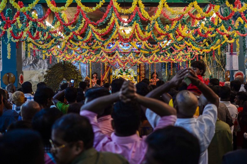 Malaysian Hindu devotees perform their religious rites during the Thaipusam festival at Batu Caves outskirts of Kuala Lumpur on February 03, 2015. The Hindu festival of Thaipusam, which commemorates the day when Goddess Pavarthi gave her son Lord Muruga an invincible lance with which he destroyed evil demons, is celebrated by some two million ethnic Indians in Malaysia and Singapore. photo Adib Rawi Yahya