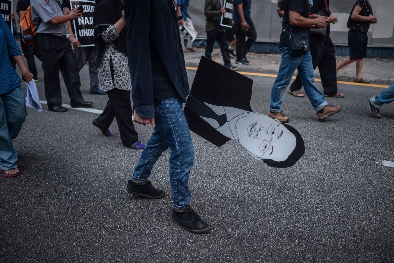 A supporters of Malaysia's opposition leader Anwar Ibrahim holds a cardboard figure of 1MDB-linked businessman Low Taek Jho during 'KitaLawan' (We Fight) rally in Kuala Lumpur on March 28, 2015. #KitaLawan rally today will call for opposition leader Datuk Seri Anwar Ibrahim's release from jail where he is serving time for sodomy, and for Prime Minister Datuk Seri Najib Razak's resignation. The demonstration has added opposition to the 6% goods and services tax (GST) to today's agenda and also coincides with the wedding reception of Najib's daughter, Nooryana Najwa, held at the Kuala Lumpur Convention Centre on the same day. photo Adib Rawi