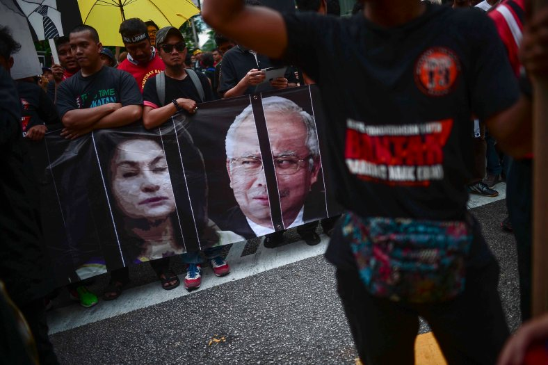 Supporters of Malaysia's opposition leader Anwar Ibrahim carry a banner during 'KitaLawan' (We Fight) rally in Kuala Lumpur on March 28, 2015. #KitaLawan rally today will call for opposition leader Datuk Seri Anwar Ibrahim's release from jail where he is serving time for sodomy, and for Prime Minister Datuk Seri Najib Razak's resignation. The demonstration has added opposition to the 6% goods and services tax (GST) to today's agenda and also coincides with the wedding reception of Najib's daughter, Nooryana Najwa, held at the Kuala Lumpur Convention Centre on the same day. photo Adib Rawi